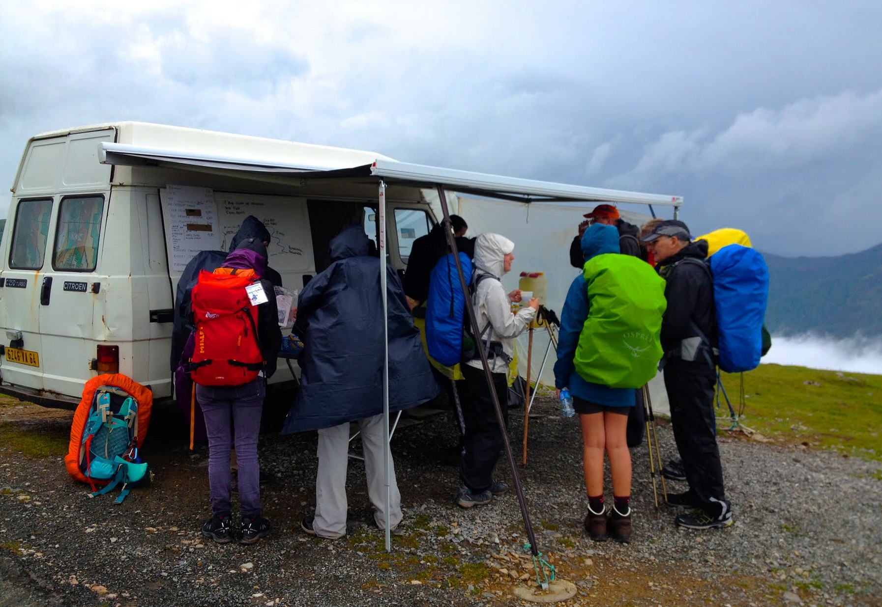 Near the top of the mountain, people huddled in the cold, crisp wind at a food truck. The driver makes the journey 9 months out of the year to sell coffee, soda, fruit, yogurt, and boiled eggs to weary pilgrims.